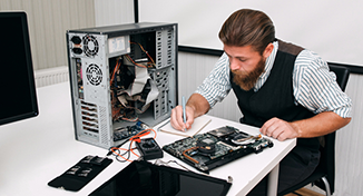 Image of A colleague fixing hardware