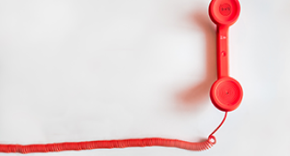 Image of a red desktop phone handle